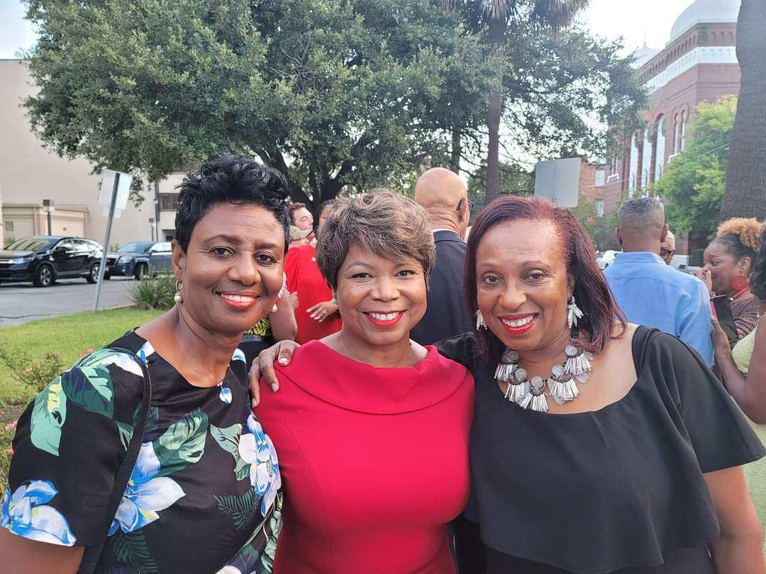 Judge Tammy Stokes, candidate for Superior Court Judge standing with 2 female supporters during the campaign video shoot outside of the Chatham Count Courthouse in Savannah, Georgia .